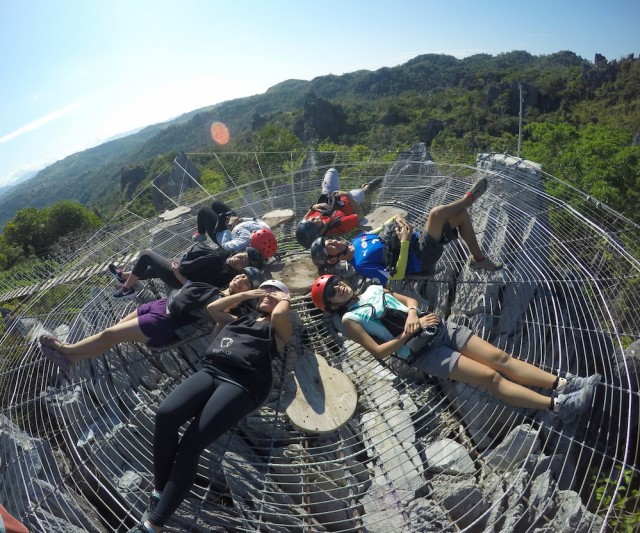 Our-group-enjoying-the-heat-of-the-sun-at-the-giant-web.-640x533